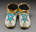American Indian Art:Beadwork and Quillwork, A Pair of Cheyenne Pictorial Beaded Hide Moccasins... (Total: 2Items)