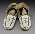 American Indian Art:Beadwork and Quillwork, A Pair of Cheyenne/Arapaho Beaded Hide Moccasins... (Total: 2Items)