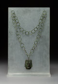 Pre-Columbian:Metal/Gold, A Mixtec Copper Necklace with Pendant...