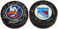Hockey Collectibles:Others, Signed Hockey Puck Lot of 2.... (Total: 2 items)