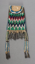 American Indian Art:Beadwork and Quillwork, An Apache Beaded Hide Strike-A-Light Bag. ...