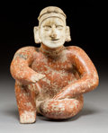 Pre-Columbian:Ceramics, A Jalisco Seated Figure with One Knee Raised...