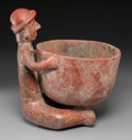 Pre-Columbian:Ceramics, A Colima Seated Figure with Large Bowl...