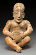 Pre-Columbian:Ceramics, An Ameca Jalisco Seated Figure Holding a Bowl...
