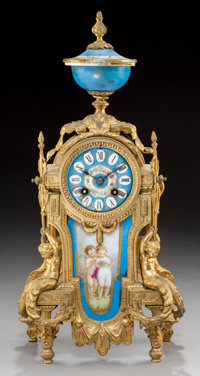 A Louis XVI-Style Gilt Metal and Porcelain Mounted Table Clock, late 19th century 17-1/4 x 8-1/4 x 4-7/8 inches (4