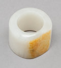 Jewelry:Rings, A Chinese Carved Pale and Russet Jade Thumb Ring. 1-1/8 x 1-1/8 inches (2.9 x 2.9 cm). PROPERTY FROM A BEVERLY HILLS ESTAT...