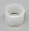 Jewelry:Rings, A Chinese Carved Pale Jade Thumb Ring. 1 x 1-1/8 inches (2.5 x 2.9 cm). PROPERTY FROM A BEVERLY HILLS ESTATE. ...