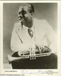 """Music Memorabilia:Autographs and Signed Items, Louis Armstrong Signed Photograph. An 8"""" x 10"""" black and whitephoto signed by the jazz legend in blue ink. In Very Good con..."""