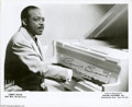 """Music Memorabilia:Autographs and Signed Items, Count Basie Signed Photograph. A 10"""" x 8"""" signed photograph of thepianist, bandleader and composer, shown at the keyboard. ..."""