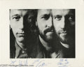 Music Memorabilia:Autographs and Signed Items, Bee Gees Signed Photograph. Formed in the mid- to late '60s as aBeatlesque ensemble, the Brothers Gibb quickly developed as...