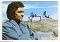 "Music Memorabilia:Autographs and Signed Items, Johnny Cash Signed Postcard. A 3"" x 5"" picture postcard featuring aphoto of Johnny Cash (taken by wife June Carter Cash) an..."