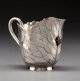 A Shiebler & Co. Japanesque Partial Gilt Silver Creamer with Applied Copper Fly, New York, New York, late 19th c...
