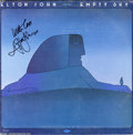 "Music Memorabilia:Autographs and Signed Items, Elton John Signed ""Empty Sky"" LP MCA 2130 Stereo (1975). Re-release copy of Elton John's debut album, signed by the venerabl..."