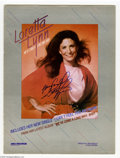 "Music Memorabilia:Autographs and Signed Items, Loretta Lynn Signed Ad. Full-page color ad for ""We've Come a LongWay Baby"" from Billboard magazine, signed by Lynn. W..."