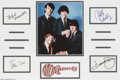 Music Memorabilia:Autographs and Signed Items, Monkees Autograph Lot. Signatures from band members Mike Nesmith,Peter Tork, Micky Dolenz, and Davy Jones matted along with...