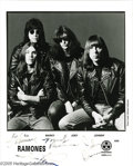 "Music Memorabilia:Autographs and Signed Items, Ramones Signed Photograph. An 8"" x 10"" black-and-white promotionalphoto (dated June, 1995) of the band in its final incarna..."