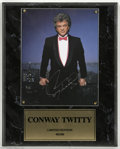 Music Memorabilia:Autographs and Signed Items, Conway Twitty Signed Photograph. Color photo mounted plaque styleand signed by late country music star Conway Twitty, who s...