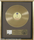 "Music Memorabilia:Awards, Madonna Gold Record Award. ""Floater""-style award presented to SireRecords in honor of the sale of more than 500,00 copies o..."