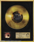 "Music Memorabilia:Awards, Ronnie Milsap Gold Record. Here is a beautiful, framed Gold Albumwith a plaque that reads, ""Presented to Country Music Star..."