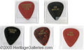 Music Memorabilia:Ephemera, Joe Walsh Guitar Picks, Group of 5 (Various). How many times have you tried to grab a pick when it's thrown from the stage, ...