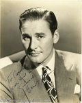 Hollywood Memorabilia:Autographs and Signed Items, Errol Flynn Signed Photograph. A signed vintage headshot of the dashing leading man whose skill at wooing the ladies inspire...