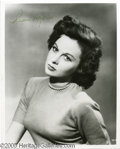 """Hollywood Memorabilia:Autographs and Signed Items, Susan Hayward Signed Photograph. A signed vintage headshot of the sexy redheaded starlet of the '40s and '50s (""""I want to Li..."""
