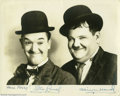 Hollywood Memorabilia:Autographs and Signed Items, Laurel and Hardy Vintage Signed Photograph. British comedians StanLaurel and Oliver Hardy appeared together by chance in 19...