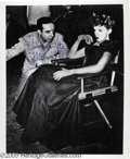 Memorabilia:Miscellaneous, Vincente Minnelli Signed Photograph. A publicity photo of Vincente Minnelli with his wife Judy Garland on the set of the 194...
