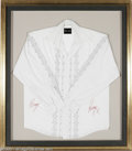 Music Memorabilia:Autographs and Signed Items, Ringo Starr Signed Shirt. White shirt with black trim signed in redfelt tip by ex-Beatles drummer Ringo Starr and personall...