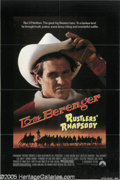 "Hollywood Memorabilia:Autographs and Signed Items, Tom Berenger Signed Poster. A loving, and rather silly, homage to the classic western, ""Rustler's Rhapsody"" posed the questi..."