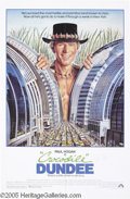 "Memorabilia:Miscellaneous, Paul Hogan Signed Movie Poster. For the 1986 romantic comedy""Crocodile Dundee,"" a modern screwball comedy that was a huge s..."