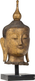 Asian:Other, A Large Southeast Asian Carved Giltwood Buddha's Head on Pedestal, 19th century and later. 37-1/2 inches (95.3 cm) (head on ...