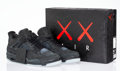 Prints & Multiples, KAWS X Nike. Air Jordan 4, 2017. Black sneakers with glow in the dark soles. Size 12. Produced by Nike Inc., Oregon. ...