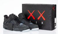 KAWS X Nike Air Jordan 4, 2017 Black sneakers with glow in the dark soles Size 12 Produced by