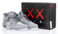 Prints & Multiples, KAWS X Nike. Air Jordan 4 Retro, 2017. Cool Grey/White sneakers with glow in the dark soles. Size 10. Produced by Nike I...