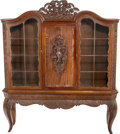 Furniture , An Austrian Carved Mahogany Figural Vitrine, produced at Kunstgewerbe Schule & Museum fur Kunst & Industrie, sculpted by T. ...