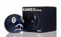 Prints & Multiples, KAWS (American, b. 1974). Cat Teeth Bank (Navy), 2007. Painted cast vinyl. 5 x 5 x 5 inches (12.7 x 12.7 x 12.7 cm). Sta...