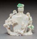 Carvings, A Chinese Carved Jadeite Snuff Bottle. 3-1/2 x 3 x 1-3/4 inches (8.9 x 7.6 x 4.4 cm). ...