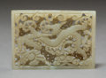 Carvings:Chinese, A Chinese Carved White Jade Reticulated Plaquewith Dragon and Wispy Cloud Motif, Ming Dynasty. 1-5/8 x 2-3/8 inches (4.1 x 6...