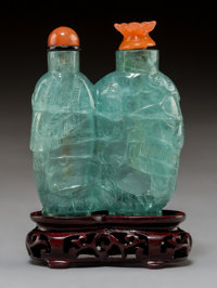 An Aquamarine Double Snuff Bottle With Carnelian Stoppers 2-1/2 x 2 inches (6.4 x 5.1 cm) (excluding stand)