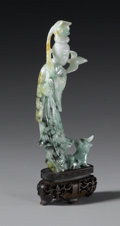 Asian:Chinese, CHINESE CARVED JADE/HARDSTONE FIGURE. Chinese carved jade/hardstonefigure of a celestial beauty, holding a lotus blossom ...