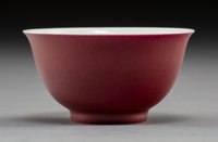 A Chinese Ruby Ground Porcelain Bowl Marks: (six-character Qianlong seal) 1-3/4 x 3 inches (4.4 x 7.6 cm)