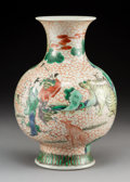 Ceramics & Porcelain, A Chinese Wucai Enameled Porcelain Vase, early Qing dynasty. 10-1/2 x 7 inches (26.7 x 17.8 cm). ...