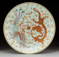, A Chinese Famille Rose Enameled Porcelain Dragon and PhoenixCharger, early Republic period. Marks: (six-charact...