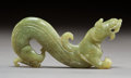 Sculpture, A Chinese Archaistic Celadon Jade Qilong Carving, Ming Dynasty. 1-1/2 x 3-1/4 inches (3.8 x 8.3 cm). ...