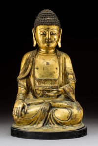 A Chinese Gilt Bronze Figure of Seated Buddha Shakyamuni, late Ming-early Qing Dynasty, 16th-17th century 20-1/2 x