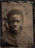 Photography:Tintypes, Large Quarter-Plate Tintype of a Smiling Young African-American Boy....
