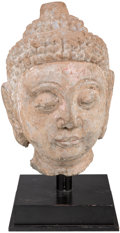 Asian:Chinese, A Chinese Carved Stone Head of Shakyamuni, Tang Dynasty, 618-907. 19-1/2 inches (49.5 cm). ...