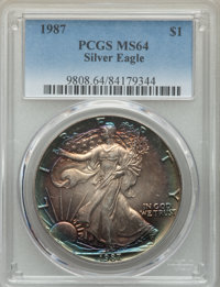 1987 $1 Silver Eagle MS64 PCGS. PCGS Population: (48/19025). NGC Census: (18/125959). Mintage 11,442,335. ...(PCGS# 9808...