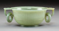Carvings, A Chinese Carved Jadeite Bowl. Marks: (apocryphal four-character Quianlong mark). 2-1/4 x 6-1/4 x 4-1/2 inches (5.7 x 15.9 x...